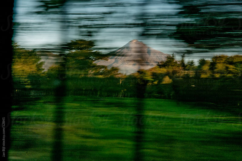 speedblur created by driving past Mount Taranak by car by Jan Bijl for Stocksy United