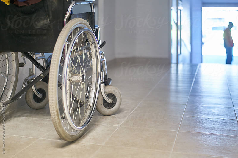 Wheelchair in a hospital by Per Swantesson for Stocksy United