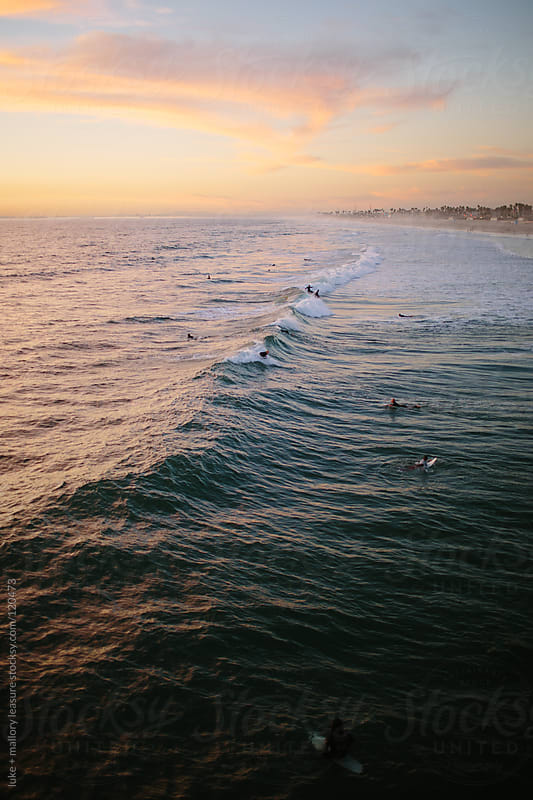 The ocean at sunset by luke + mallory leasure for Stocksy United