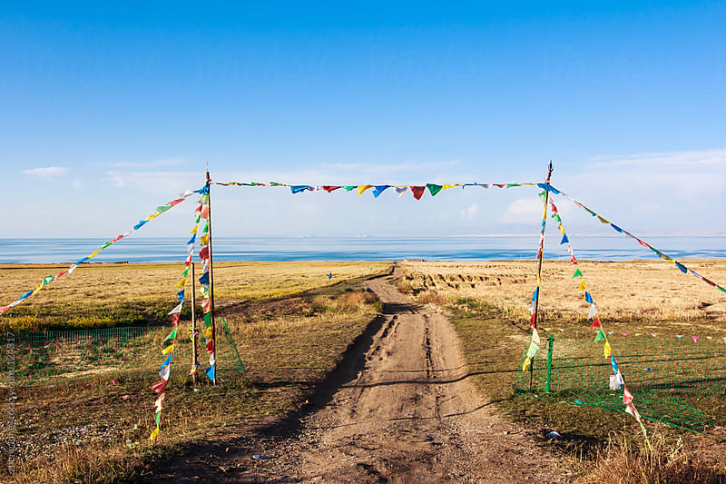 Prayer flags beside Qinghai lake by zheng long for Stocksy United
