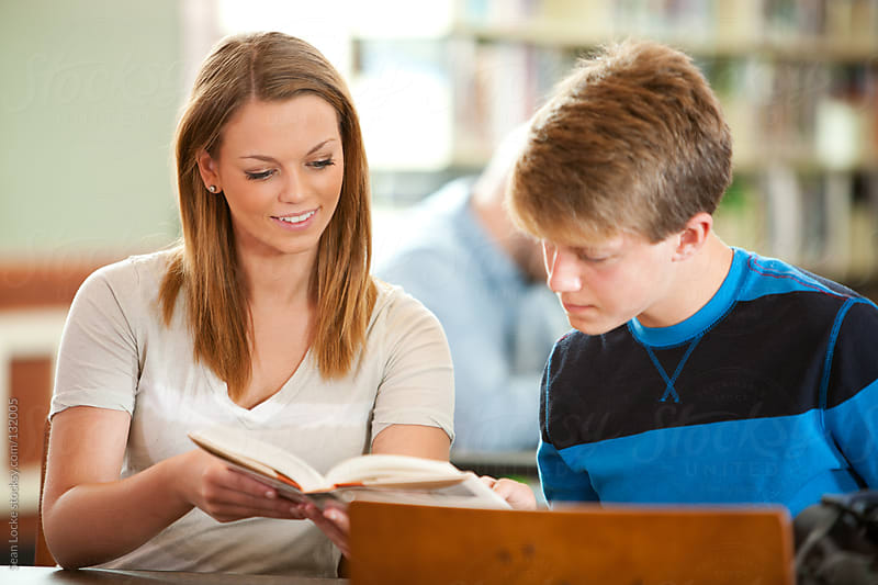Library: Tutoring Another Teen in the Library by Sean Locke for Stocksy United