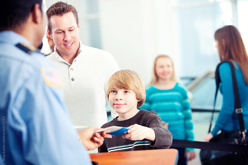 Airport: Young Boy Shows Ticket to Security by Sean Locke for Stocksy United