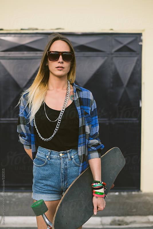 Portrait of a young woman with longboard by Brkati Krokodil for Stocksy United