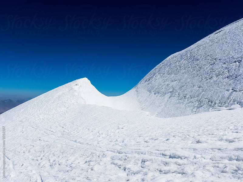 snow capped mountain tops by unite  images for Stocksy United