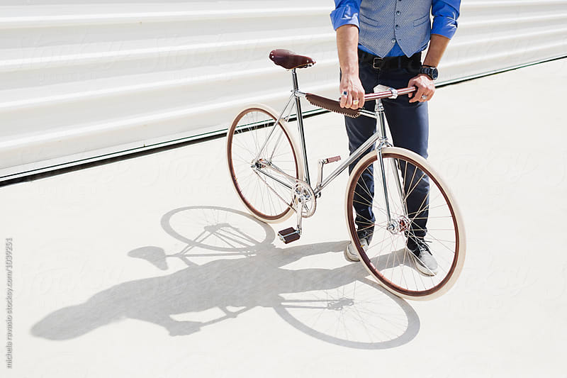 Man holding vintage bicycle by michela ravasio for Stocksy United