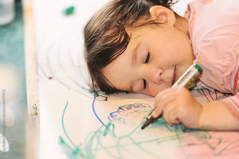 Little Girl Falling Asleep while Drawing by Gary Radler Photography for Stocksy United