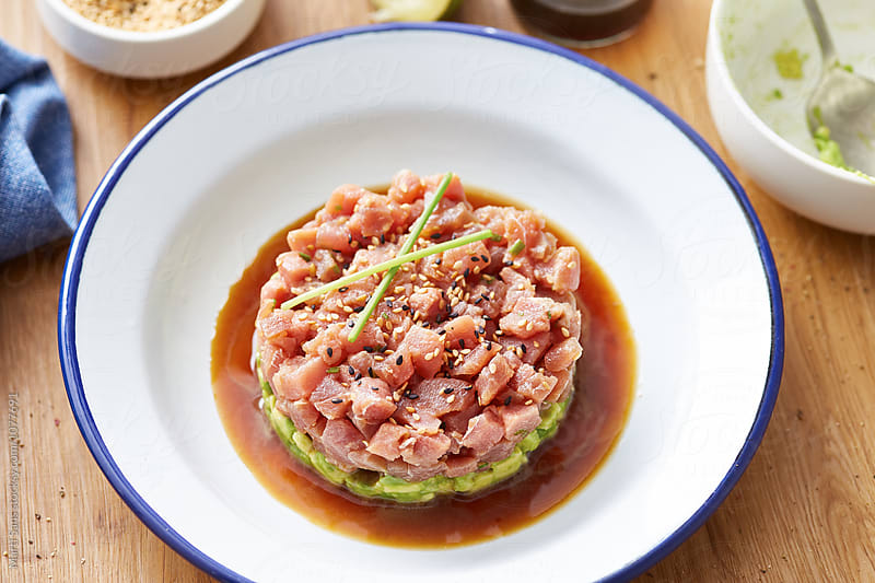 Served tuna tartare on plate with soy sauce by Martí Sans for Stocksy United