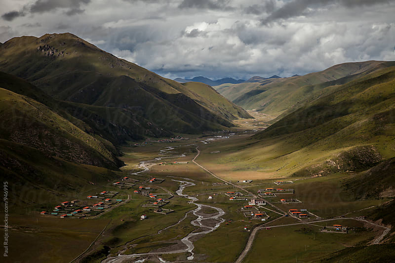 Plains near Larung Gar Buddhist Academy by Paul Ratje for Stocksy United