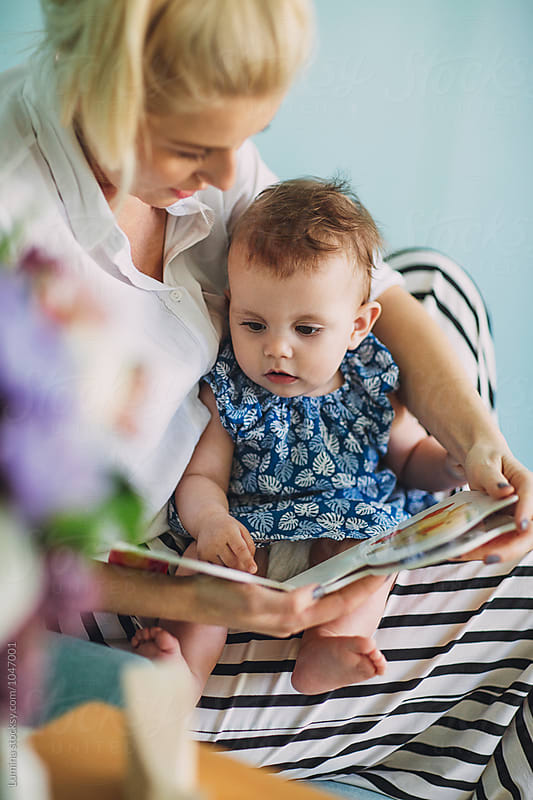 Woman Reading to a Baby by Lumina for Stocksy United