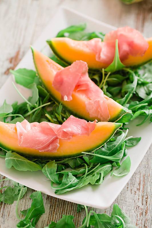 Prosciutto and Melon  by Davide Illini for Stocksy United