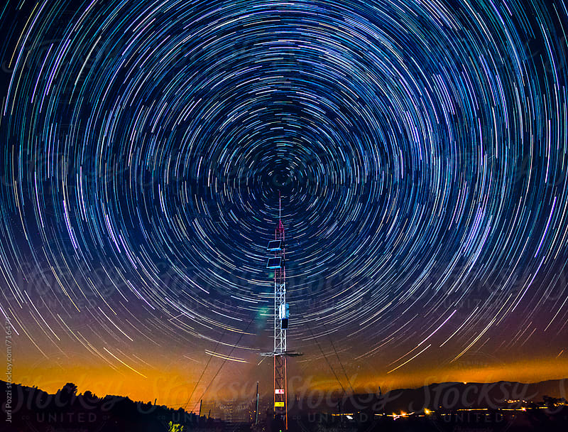 radio antenna and concentric startrails by Juri Pozzi for Stocksy United