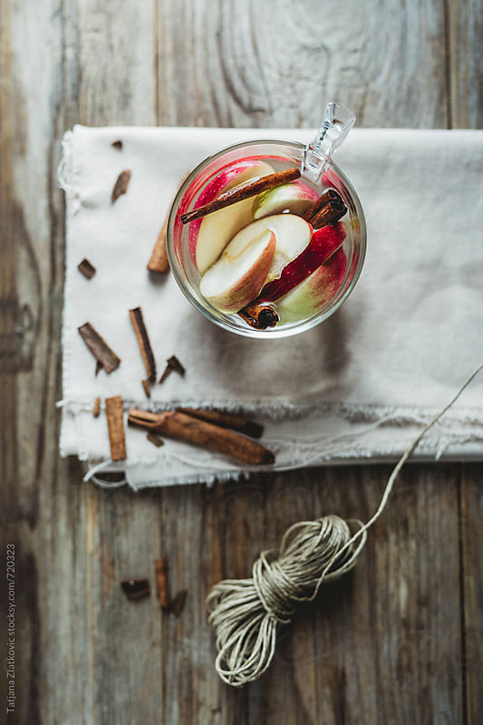 Cold water with apple and cinnamon by Tatjana Ristanic for Stocksy United