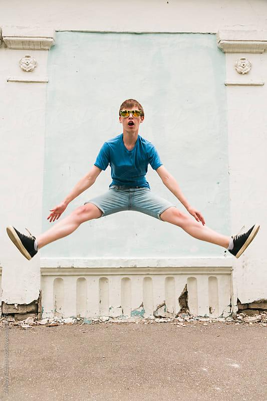 teen boy jumping  by Alexey Kuzma for Stocksy United