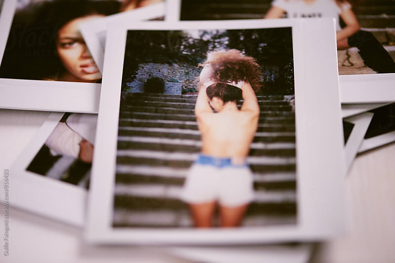 form behind: polaroid of young afro american brunette nude by Guille Faingold for Stocksy United