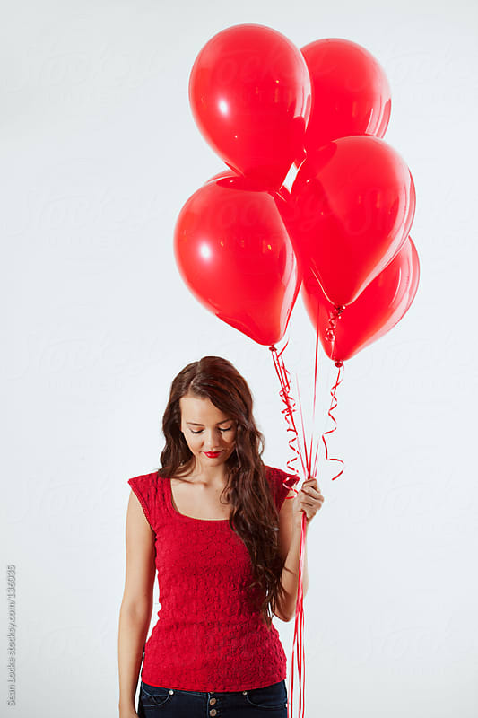 Valentine's: Woman Holding Bouquet of Balloons by Sean Locke for Stocksy United