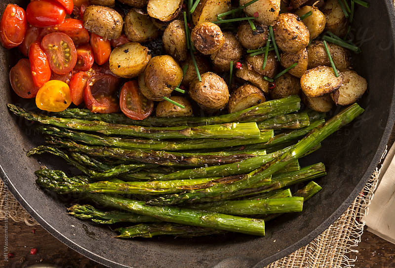 Grilled Asparagus, Potatoes and Cherry Tomatoes by Jeff Wasserman for Stocksy United