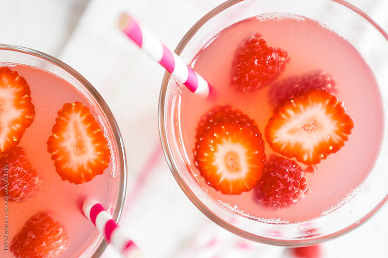 Summer Fruit Drink Including Rasberries and Strawberries by Jeff Wasserman for Stocksy United