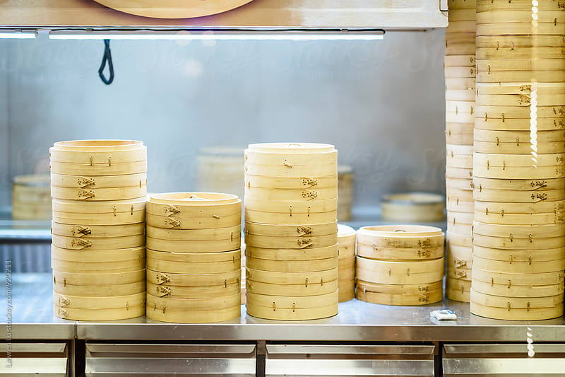 Many steamers piling up for steaming dumplings by Lawren Lu for Stocksy United