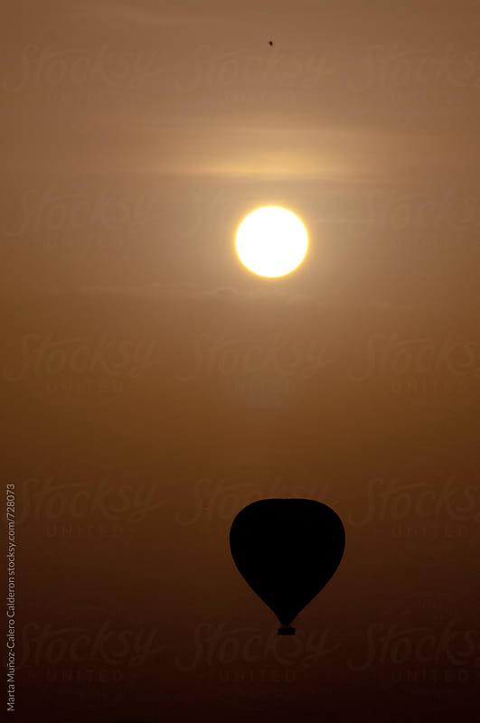 Hot Air Balloons At Sunrise at Kenia by Marta Muñoz-Calero Calderon for Stocksy United