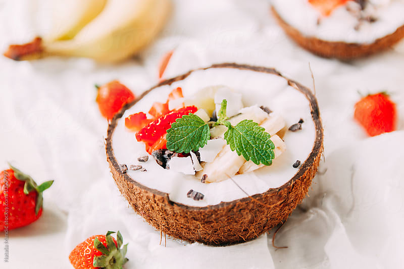Breakfast in a coconut by Nataša Mandić for Stocksy United