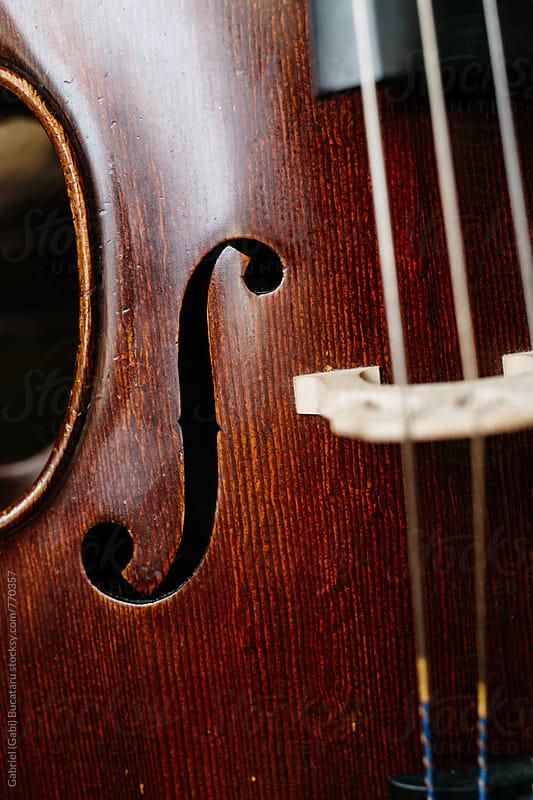 Cello F-hole by Gabriel (Gabi) Bucataru for Stocksy United