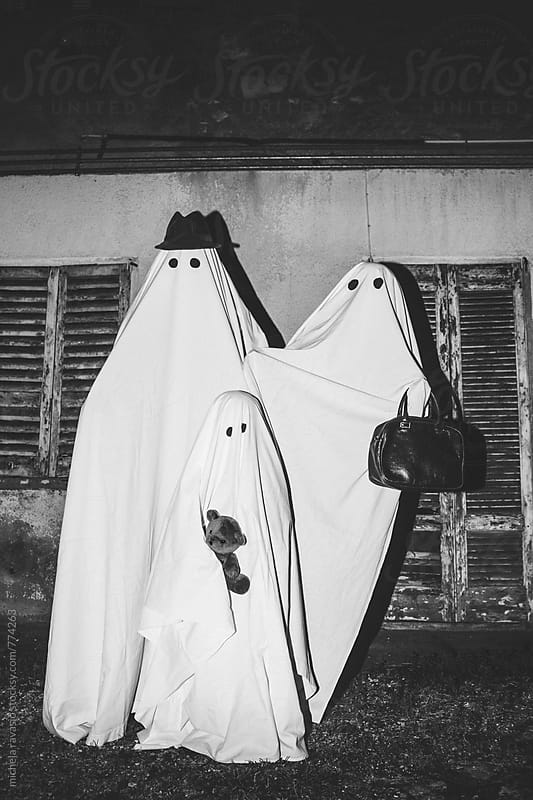 Portrait of family of ghosts in front of their home by michela ravasio for Stocksy United