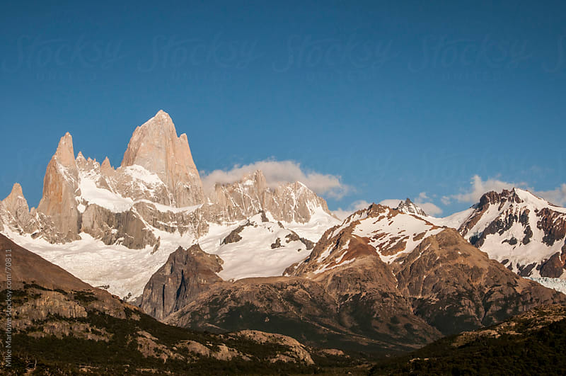 Snow covered granite peaks in Patagonia. by Mike Marlowe for Stocksy United