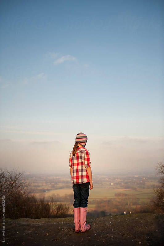 child looking at a landscape view by Lee Avison for Stocksy United