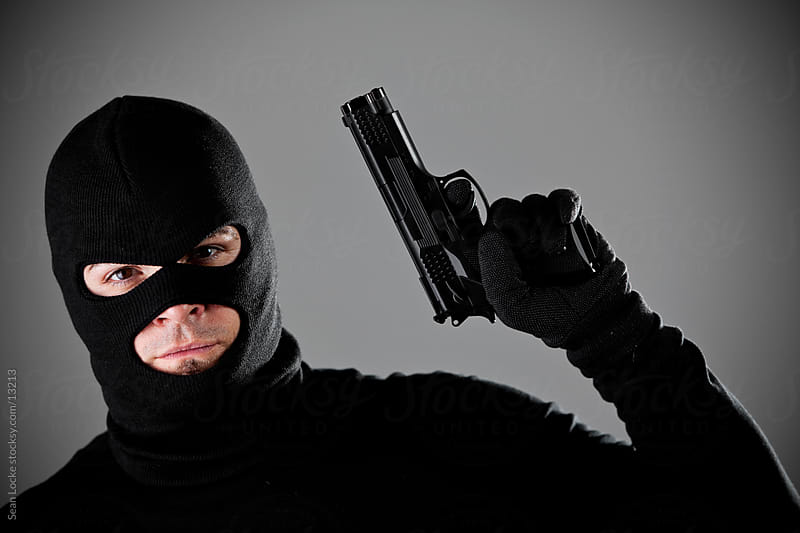 Burglar: Serious Criminal with Gun by Sean Locke for Stocksy United