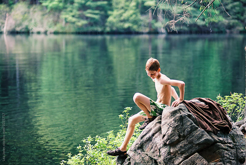 kids swimming in lake by Léa Jones for Stocksy United