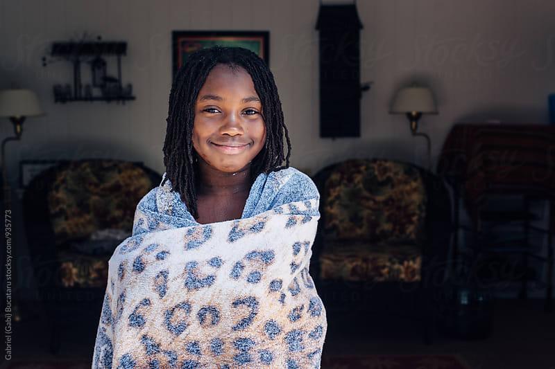 Smiling black girl in a beach towel by Gabriel (Gabi) Bucataru for Stocksy United