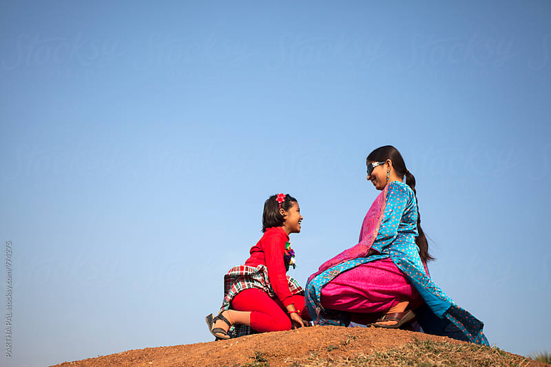 Mother and daughter in conversation by PARTHA PAL for Stocksy United