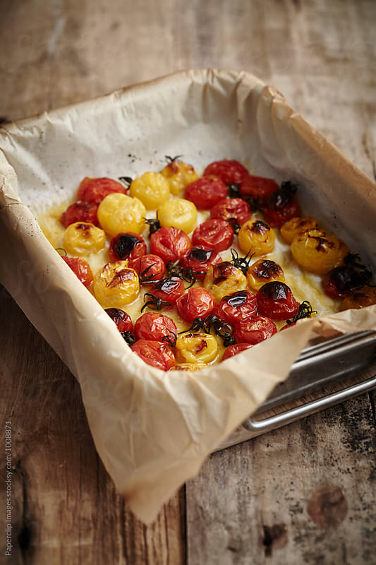 Oven-dry Heirloom Cherry Tomatoes  by Paperclip Images for Stocksy United