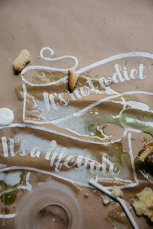 Conceptual photo of failed attempt to eat healthy by Beatrix Boros for Stocksy United