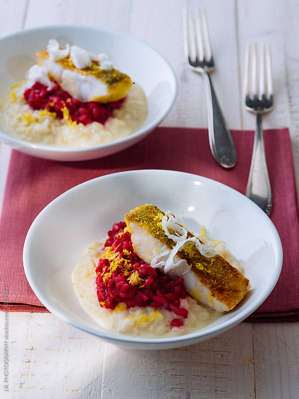 Beetroot risotto with pike perch by J.R. PHOTOGRAPHY for Stocksy United