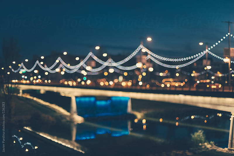 bridge with christmas lights decoration by Javier Pardina for Stocksy United