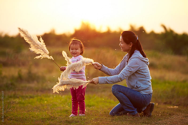happy little girl with her mother outdoor in the autumn rural by Bo Bo for Stocksy United