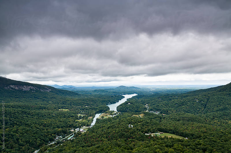 Storm clouds over a river valley by Adam Nixon for Stocksy United