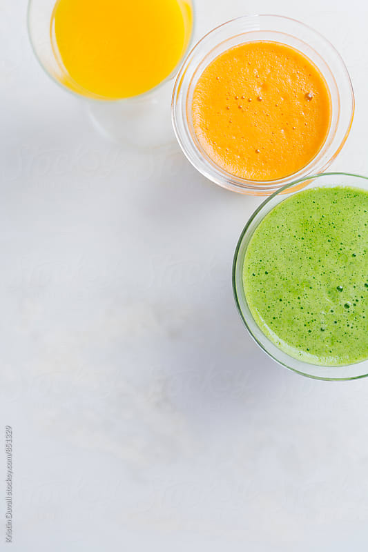 Fresh green juice with citrus juices by Kristin Duvall for Stocksy United