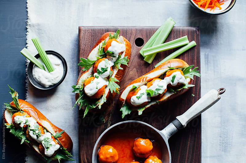 Pretzel subs by Ellie Baygulov for Stocksy United