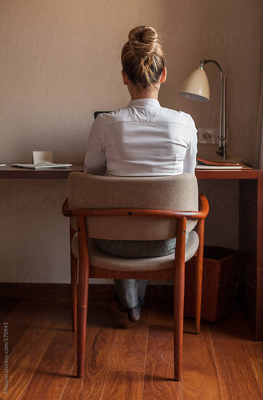 Back Shot of a Businesswoman in a Hotel Room by Mosuno for Stocksy United
