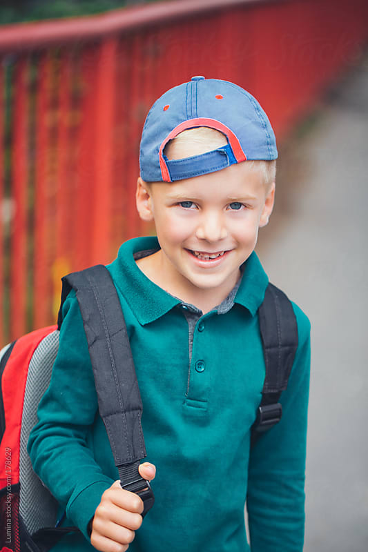 Cute Schoolboy Smiling by Lumina for Stocksy United