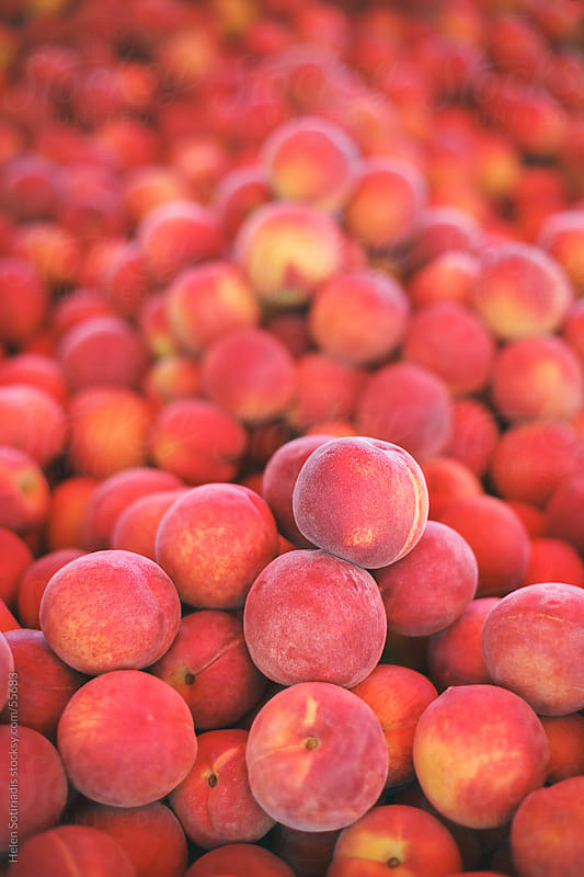 Fresh peaches at the local market by Helen Sotiriadis for Stocksy United