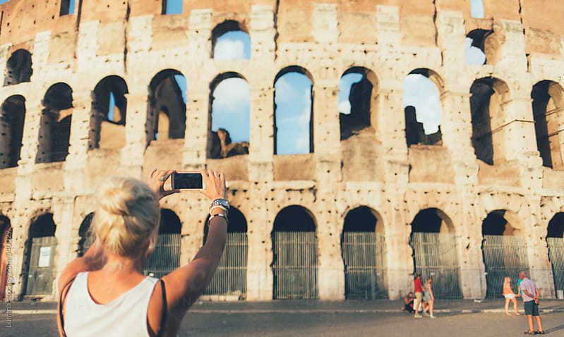 Tourist Takes a Photo of the Colosseum by Lumina for Stocksy United