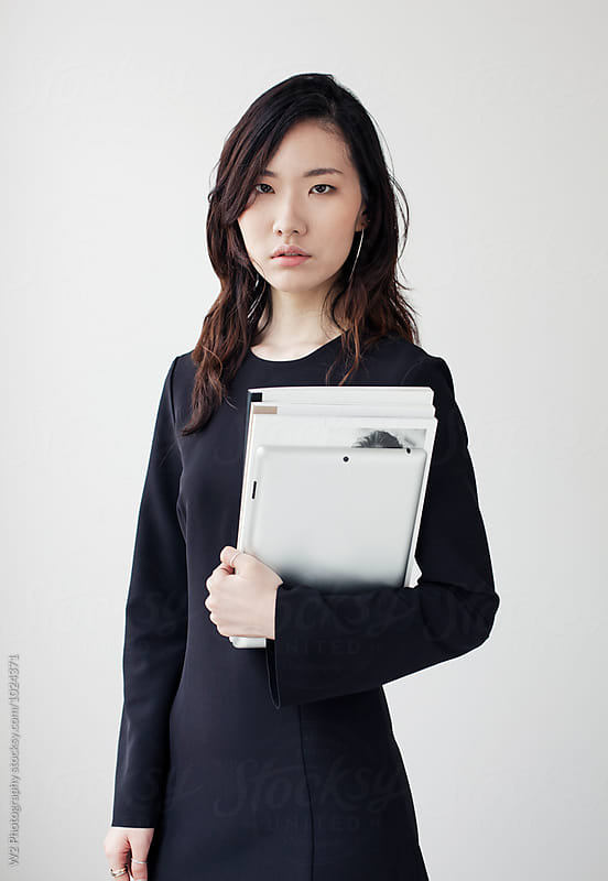portrait of a student holding books and a tablet pc. by W2 Photography for Stocksy United