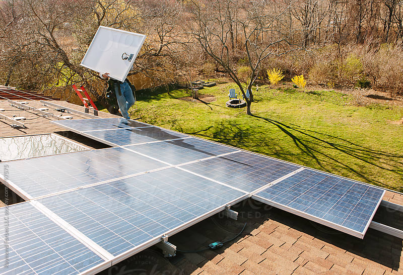 Solar Panel Installation on Home by Raymond Forbes LLC for Stocksy United