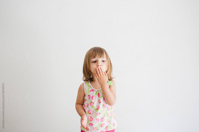 Cute little girl sending a kiss by michela ravasio for Stocksy United