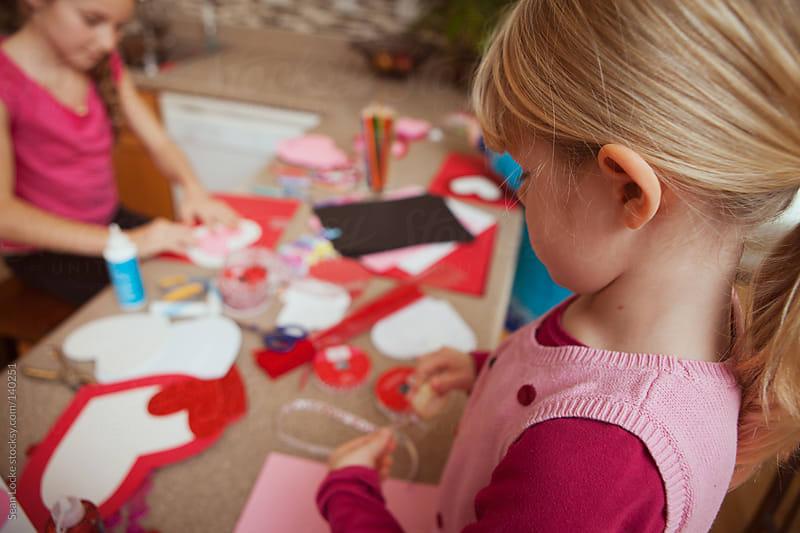 Valentine: Girls Working On Valentine Cards by Sean Locke for Stocksy United