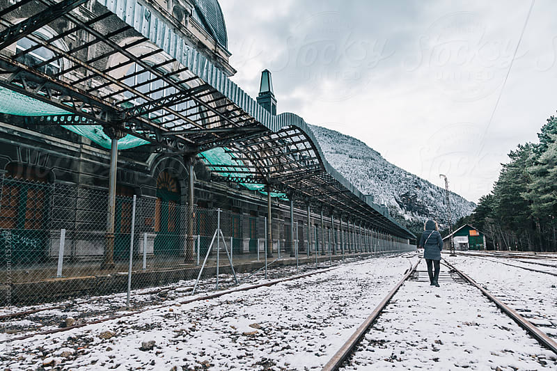 Woman Walking Along a Railway by VICTOR TORRES for Stocksy United