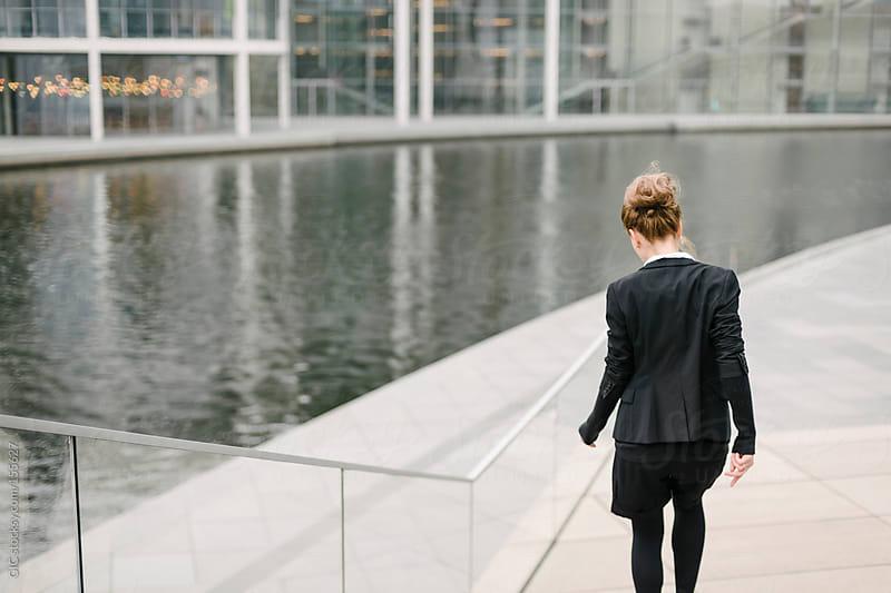 Businesswoman walking in Berlin by GIC for Stocksy United